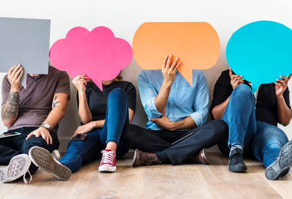 Have you say a line of people holding thought and speech bubbles